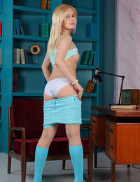 Horny and amazingly sexy blonde teen gets off her sexy skirt and undies to show you her mind blowing tits.